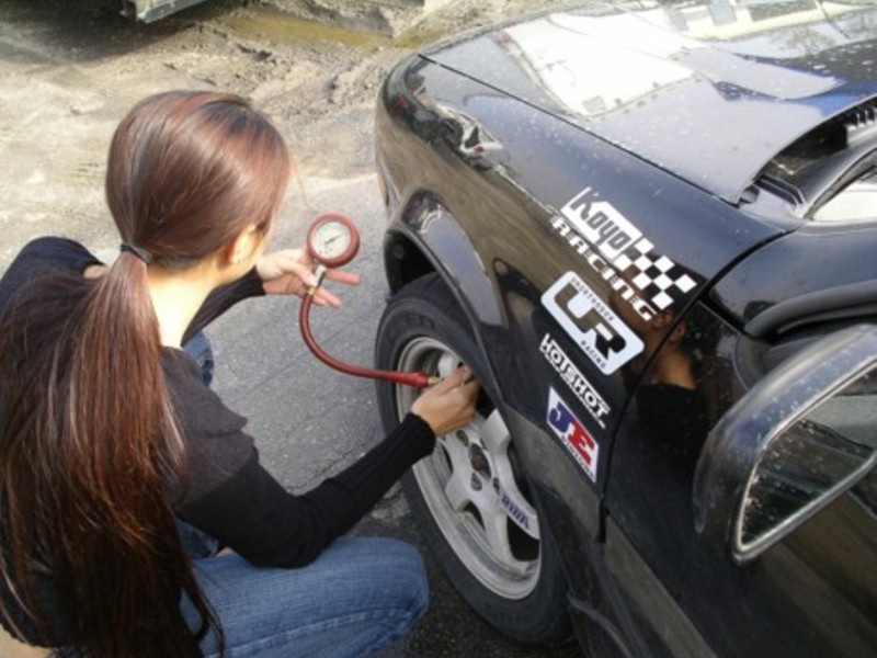 Project Racer Adjusting Tire Pressures Before a Run