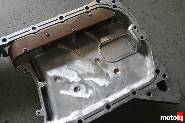 Nissan SR20DE oil pan modifed for windage tray clearance